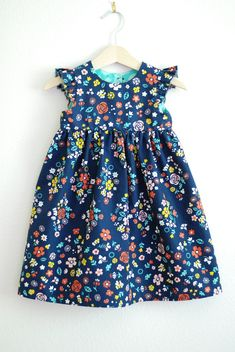 Gorgeous fabrics, inspiration and free dress pattern Pattern is for different dress Sizes 6-12 months 3/4 yr.