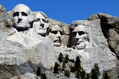 "Mount Rushmore National Memorial in the Black Hills of South Dakota   ""The purpose of the memorial is to communicate the founding, expansion, preservation, and unification of the United States with colossal statues of Washington, Jefferson, Lincoln, and Theodore Roosevelt."""