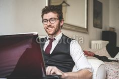 elegant attractive fashion hipster man using notebook from $1