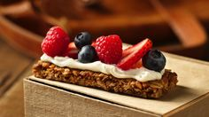 Grabbing a granola bar for a snack is a good idea. Topping it with cream cheese and berries takes it to an irresistible new level.