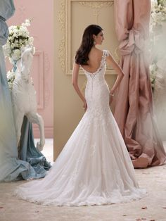 David Tutera for Mon Cheri - 115239 – Emerson -     Lace cap sleeve wedding dress, venise lace and tulle over luxurious satin fit and flare wedding dress with lace slight cap sleeves, sweetheart neckline features an illusion and lace modesty piece, Venise lace bodice with exaggerated dropped waistline, illusion and lace deep plunging open back bodice finished with cascading covered button closures, tulle over luxurious satin skirt with matching Venise lace motifs cascading down to scalloped…