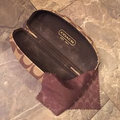 Coach sunglasses case Clam shell style Includes lens cloth. Never been used. Coach Accessories Sunglasses