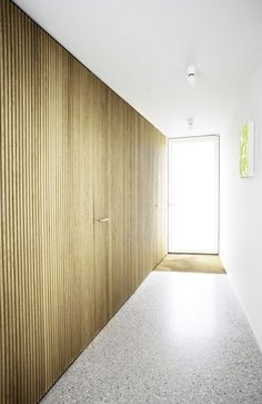 Wooden wall with beautiful polished concrete (?) floor. House NMS by Belgian office Dierendonck - Blancke Architecten.