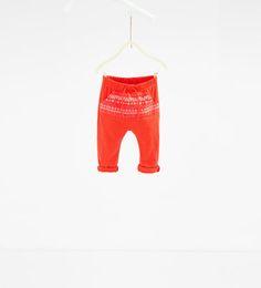 изображение 1 из Брюки с вышивкой от Zara