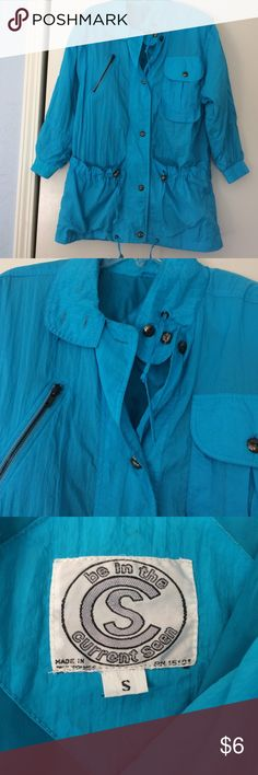 Light blue nylon jacket Size SM, buttons of front with lots of pockets, excellent condition. be in the current scene Jackets & Coats