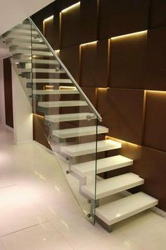 Love the metal and glass side railing to this floating staircase