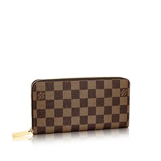 Discover Louis Vuitton Zippy Wallet: This iconic wallet just got an upgrade! Now with four additional credit card slots, the Zippy Wallet in Damier Ebene canvas is more versatile than ever.