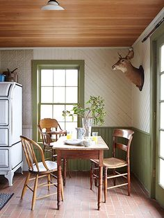 The kitchen's oak table and mismatched chairs are flea-market finds; the turn-of-the-century high chair (used by the couple's 18-month-old son, Charlton) is a hand-me-down from a friend.#countryliving #diningrooms