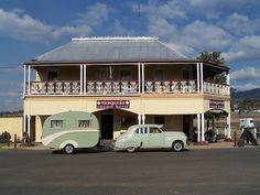 """Maryvale Crown Hotel NSW with 1957 Kit built caravan called """"Driftwood"""" and 1955 FJ Holden sedan"""