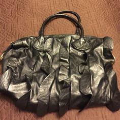 Black ruffled Steve Madden Bag Used but still in good condition Black Ruffled Steven Madden Satchel.  Lots of use left in this lovely bag Steve Madden Bags Satchels
