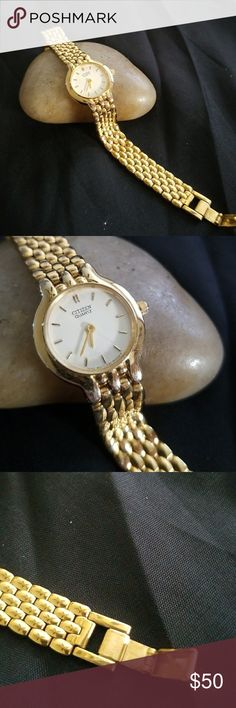Ladies citizen watch. Smaller, delicate ladies citizen watch in gold over stainless. White, round dial and great work watch. Slightly worn with little wear. Citizen Accessories Watches