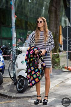 #CarlottaOddi platform clogs and knit poncho. Milan