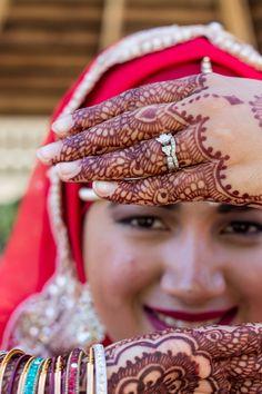 Muslim Hijabi bride showing bridal mehndi (Indian/Pakistani style henna design)
