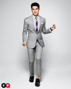 Make Your Business Suit Dance  Remember, you make conference calls in that same gray suit. It can work here, too…but all the underpinnings have to project a seriously amped-up party vibe. A brash tie—and magically disappearing socks—is a good start.  Image courtesy of GQ Magazine. Photographys by Kai Z Feng.
