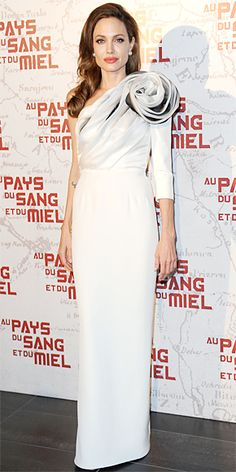 Angelina Jolie turned heads at the French premiere of In the Land of Blood and Honey in a single-sleeve Ralph & Russo gown and pearl studs.