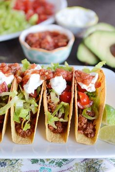 The Best Ground Beef (or Ground Turkey) Tacos Three tacos lined up side-by-side on a plate filled with ground beef and topped with lettuce, sour cream, and salsa. Clean Recipes, Healthy Dinner Recipes, Mexican Food Recipes, Cooking Recipes, Ethnic Recipes, Healthy Meals, Quick Recipes, Ground Turkey Tacos, Crunch