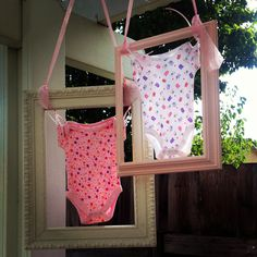 Framed onesies for babyshower. I wish I could throw one for my sister.