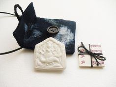 Handmade Lakshmi wealth pendant, Goddess amulet / talisman pouch, cream clay Goddess relief & sacred mantras in handmade indigo pouch by GaneshasRat on Etsy
