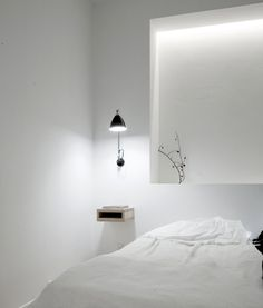 Copenhagen Penthouse by Dannish architects Norm Architects. I love the white walls and light coloured floor creating a sens of lightness. The concealed indirect lighting is beautifull and adds to the light atmosphere.