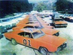 """A vehicle lot of spare """"General Lee"""" 1969 Dodge Chargers, police cars, and among a few other vehicles used on The Dukes of Hazzard TV Show. Not sure on the exact date, but OldSchoolCool nonetheless. Somewhere betwen - Car Hot Wheels, General Lee Car, Mustang, Dukes Of Hazard, Dodge Muscle Cars, 1969 Dodge Charger, Automobile, Sweet Cars, Us Cars"""
