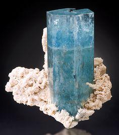 Beautiful blue crystal of Beryl var. Aquamarine set atop Albite. From the Erongo Mountains, Namibia, SW Africa.