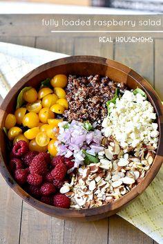 Fully Loaded Raspberry Salad - with quinoa, almonds, mixed greens, shallots, yellow cherry tomatoes, raspberries, feta, and raspberry balsamic vinaigrette