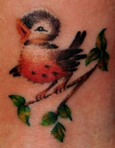 Awh, if I were to ever get a tatoo (I won't. Brian hates them.) I would get a little cat that looks along the lines of this adorable little bird. So cute!