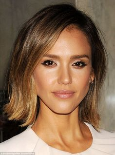 Stylish: Alba wore a dramatic eye and natural lip to the Impact Awards in Los Angeles in March