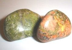 """Unakite, also called epidote, derives its name from the Greek epidosis, meaning """"growing together"""". It is a combination of red jasper and green epidote solidly bound together. From this we get the meaning that what comes together belongs together.  Unakite (or Epidote) can be used to draw off negative energy and blockage from the Heart Chakra.  Unakite is said to lift your spirits when you are feeling down - this is the gemstone to help you to see the beauty in life."""