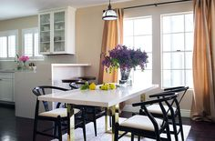 "The dining area, which features a custom quartz-and-brass table and Danish chairs, is getting more use by Louise and her fiancé in a conscious effort to balance their hectic schedules. ""We now do breakfast, lunch, and dinner most days,"" she says. ""And I think it's important to have a place to regroup from the day and have a chat rather than collapse in front of the TV."""