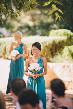 Bridesmaid dresses - Turquoise with white flowers look pretty