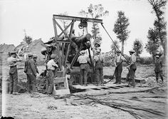 MINISTRY INFORMATION FIRST WORLD WAR OFFICIAL COLLECTION (Q 2906)   Battle of Polygon Wood: Men of the Royal Garrison Artillery loading a 15-inch howitzer, Mark II, 27th September 1917.