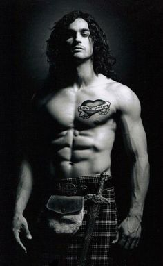 weakness for Scottish/Irish men... now if I could just hear him TALK... there's nothing sexier than a Scottish/Irish accent! Not fond of the mom tattoo
