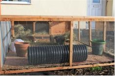 DIY Rabbit Hutch   The rabbits can come in and out of the hutch, exercise, play, and rest ...