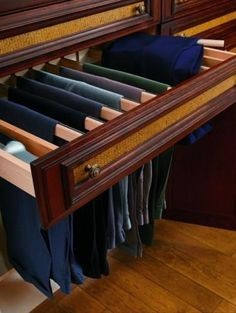 Master closet suite pant rack. Choose a different style but very smart idea.