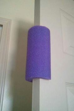Use a pool noodle as a door stop for little ones