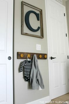 wall initial with hooks. perfect!