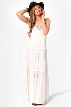 White maxi dress with blue embroidery.