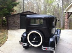 Rear picture of my 1929 Model A Ford. This is the carriage house I built to store the Ford in. I'm it's care-taker and owner, and am trying to preserve a piece of original American History.