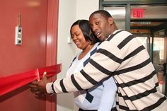 A family partner cut the ribbon to her new home.  BECOME A HOMEOWNER!
