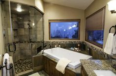 Master bathroom with soaking tub and steam shower.