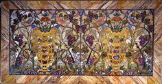 Piano di tavolo con vasi di fiori, uccelli, tralci d'uva e spighe, Giovan Battista Sassi e Jacopo Flach su disegno di Jacopo Ligozzi (1603-1610; Firenze, Galleria Palatina di Palazzo Pitti)