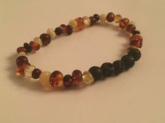 Lava Rock Diffuser Bracelet - Baltic Amber by HarpersHandmadeCo on Etsy https://www.etsy.com/listing/280780390/lava-rock-diffuser-bracelet-baltic-amber