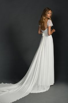 Romantic cap sleeved lace and chiffon wedding dress with soft train | See more: http://theweddingplaybook.com/classic-black-gold-white-wedding-inspiration/