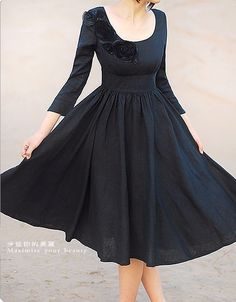This reminds me so much of the dress Julie Andrews wears in The Sound of Music, the ugly one... only in black :D