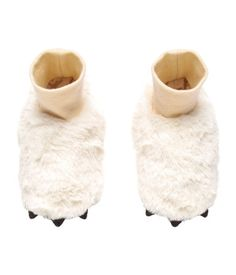 White. Slippers in soft pile with jersey ribbing at top, jersey lining, and soft soles with non-slip protection.