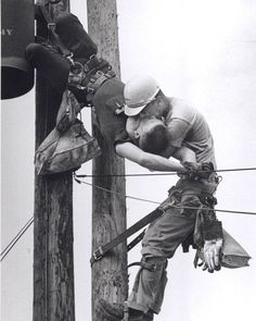 """The Kiss Of Life"" Electrical Line Man gives mouth to mouth to his co-worker after he had his heart stopped by electrocution.This intervention saved his life.He was eventually brought to the ground and revived by cpr by the time paramedics came. 1967."