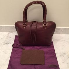 Genuine Italian leather handbag Brown espresso leather handbag designed by Linea Pelle. Never used. Italian cowhide leather, no lining, zipper closure, shoulder bag. Small detachable purse included that snaps into the handbag if needed. Purse bag included. Retail price was $300, however, I purchased the bag on sale for $200. Linea Pelle Bags Shoulder Bags