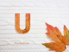 Uppercase letter U with glitter leaf and sweater knit. #fall #autumn #alphabet #typography #initial #monogram #font | maple leaf
