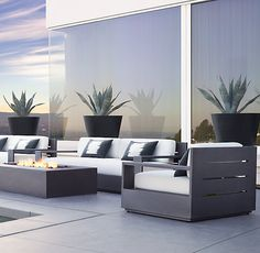"""RH's 108"""" Marbella Aluminum Sofa:Low-slung and linear, with clean, right angles and boxed bases, Marbella is pure modernism. Ultra-deep seats and upright backs are padded with thick cushions that beckon relaxation. Built of enduring aluminum, the collection offers a timeless aesthetic."""